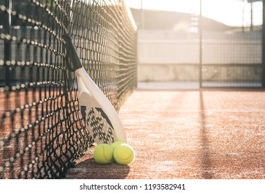 Padel blade racket resting on the net