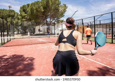 padel tennis players in action during a match outdooor