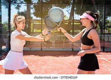 padel tennis women play on an outdoor court in summer