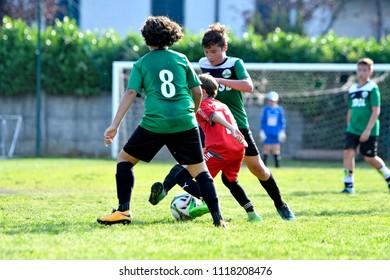 PADERNO DUGNANO, ITALY-JUNE 09, 2018: european soccer children match between Italian and Swedish teams, at the Oratorio's soccer field, in Paderno Dugnano, near Milan.