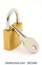padlock and key on white