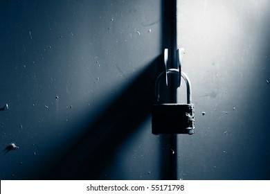 Padlock lock on metal gates background.