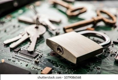 Padlock on computer circuit board.Security concept