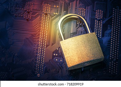 Padlock on computer motherboard. Internet data privacy information security concept. Toned image