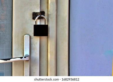 padlock on door of closed store