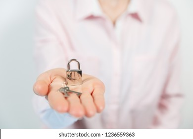 Padlock on the hand metal lock isolated on white background - Security Concept