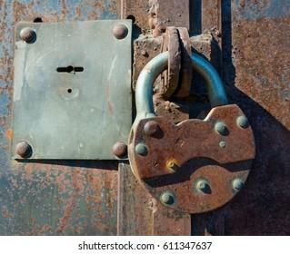 the padlock on the iron door