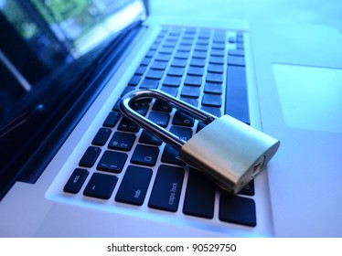 A padlock on keyboard. Data security and protection.