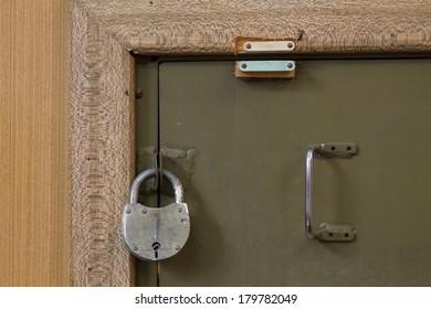 padlock on old door safe closeup