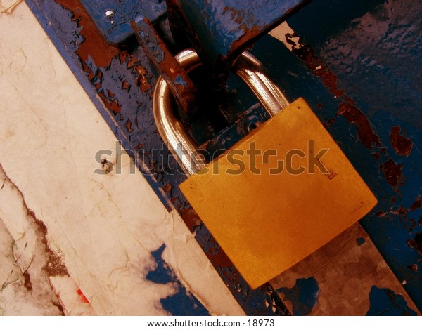 Padlock on a rusty background with old paper peeling off.