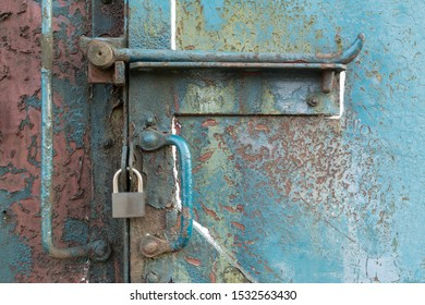 Padlock on a steel container.