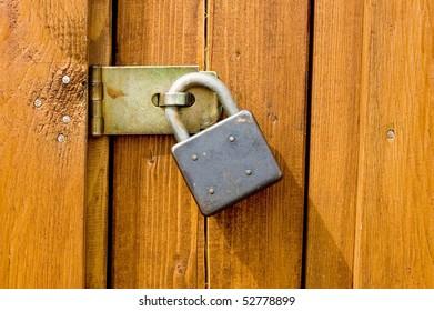 Padlock on wooden background