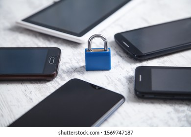Padlock with smartphones. Mobile security