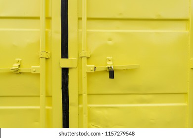 Padlock in a yellow container