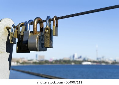Padlocks hang on steel rope for wishing love or marriage