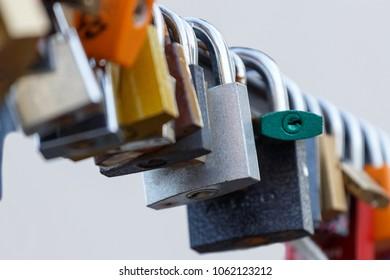 Lot of padlocks hanging on bridge. Concept represent forever love