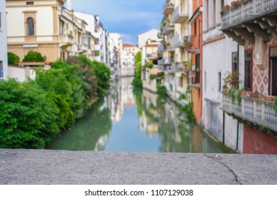 Padova, Italy - May, 6, 2018: Houses on a bank of channel in Padova