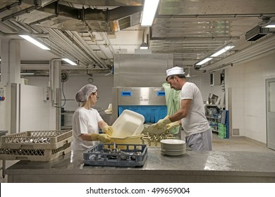 PADOVA, ITALY-MAY 14, 2015: dishwashers working in an industrial kitchen canteen of a retirement home, in Padova.