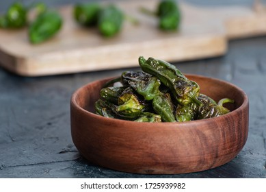 Padron peppers on wooden bowl. Typical spanish food. Healthy food. Traditional Spanish green paprika.