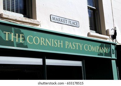 "Padstow, Cornwall, UK - April 6th 2017: Exterior of ""The Cornish Pasty Company"" food shop. Pasties are a traditional Cornish meat and vegetable pie"