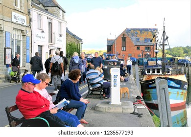 Padstow, Cornwall, UK. October 08, 2015.Holidaymakers walking and relaxing on the busy quayside in October at Padstow in Cornwall, UK.