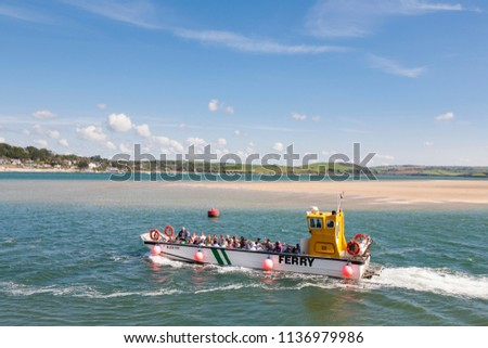 PADSTOW, UK - SEPTEMBER 21, 2010 : A ferry packed with people crossing the Camel Estuary from Padstow to Rock in Cornwall, England