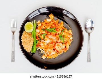 Padthai, Fried noodle thai style with shirmp on white table.