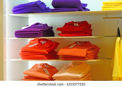 PADUA, ITALY -2 MAY 2018- View of colorful Lacoste polo shirts on store shelves. Lacoste is a French clothing company famous for its tennis shirts.