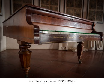 Padua, Italy - April 2, 2018: Antique Emerich Betsy piano constructed in 1854. These pianos were made with Burl Wood, each finished with hand craftsmanship inclusive of hand-carved gold.