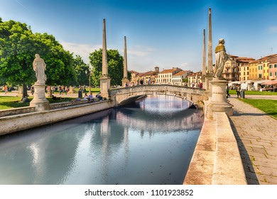 PADUA, ITALY - APRIL 28: The scenic square of Prato della Valle and its beautiful canal in Padua, April 28, 2018. It is the largest square in Italy, and one of the largest in Europe