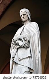 Padua / Italy - July 24 2019: Dante's statue under the arcades of Loggia Amulea