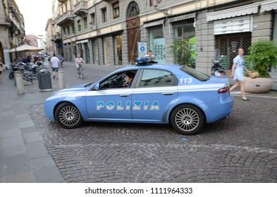 "PADUA, ITALY - JUNE 18, 2012: Fast moving Italian police car Alfa Romeo 159 Squadra Volante - italian mobile squads, often called ""flying squads""."