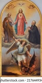 PADUA, ITALY - SEPTEMBER 10, 2014: The paint of The Heart of Jesus, archangel Michael and other saints from 19th century by unknown painter in side chapel of church chiesa di Santa Maria del Torresino.
