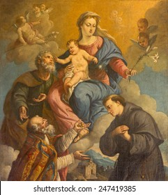 PADUA, ITALY - SEPTEMBER 10, 2014: The Holy Family and saints Nicholas and Anthony of Padua by unknown painter of 18. cent in the church of st. Nicholas.