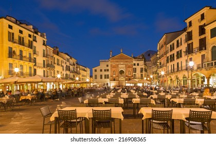 PADUA, ITALY - SEPTEMBER 11, 2014: Piazza dei Signori square with the church of San Clemente in the background in evening dusk.