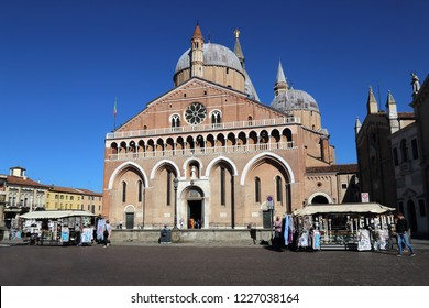 Padua, Italy - September 28, 2018: People at tourist stalls in front of the Basilica of Sant Antonio in Padua, Italy on September 28, 2018
