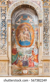 PADUA, ITALY - SEPTEMBER 9, 2014: The Madonna with the child by Bonino da Campione (14. cent.) in the church of The Eremitani (Chiesa degli Eremitani) on the tomb of Umberto da Carrara.