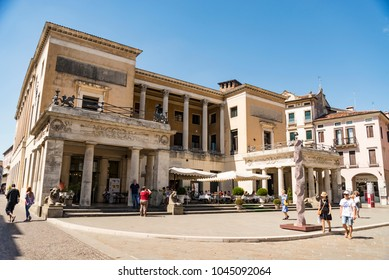 PADUA - JULY 2, 2017: people walk near the entrance of one of the oldest university in Europe. It is also a popular touristic European destination on July 2, 2017 in Padua