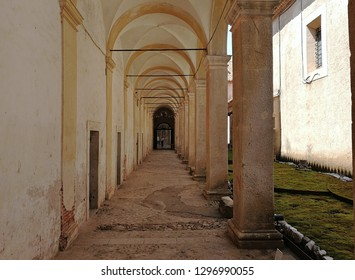 Padula, Salerno, Campania, Italy - August 5, 2018: Portico of the Court of the Granaries at the Certosa di San Lorenzo