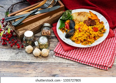 Paella with chicken, seafood and chorizo