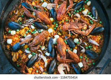 Paella  with crabs at the stake.Cooking food on a fire .Picnic.