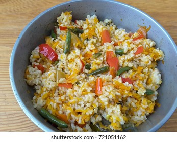 Paella rice and vegetables cooking healthy vegetarian food
