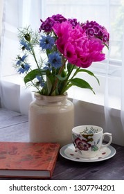 Paeonia officinalis (peony) , Dianthus barbatus (Sweet William),and Nigella damascena (Love in the mist) with a vintage coffee cup and sketch book.