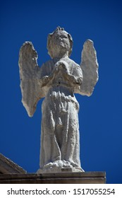 PAG, CROATIA - AUGUST 03, 2013: Angel, statue on the portal of Church of the Assumption of the Virgin in Pag, Croatia
