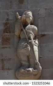 PAG, CROATIA - AUGUST 03, 2013: Saint George, statue on the portal of Church of the Assumption of the Virgin in Pag, Croatia