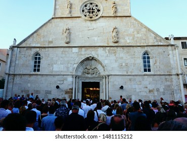 Pag, Croatia, August 15, 2019. A lot of people in front of an open church of Saint Mary in Croatian town of Pag on the island of Pag