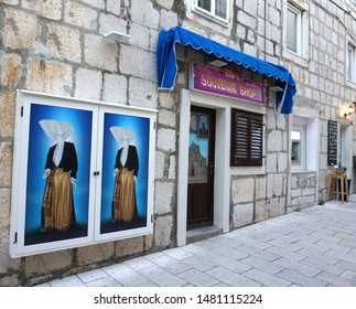 Pag, Croatia, August 15, 2019. Closed souvenir shop in the Croatian town of Pag with the traditional features of a woman in traditional costume on the front