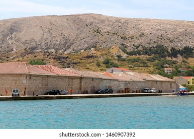 Pag, Croatia - July 7, 2019: View of historical salt warehouse in town Pag, on island Pag, Croatia.