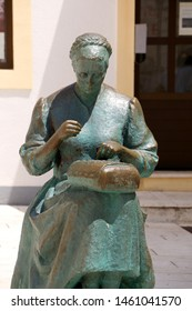 Pag, Croatia - July 7, 2019: Monument dedicated to female embroiderer in town Pag, on island Pag, Croatia. Embroidery and lace work is traditional symbol of Pag.
