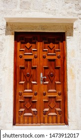 Pag, Croatia, July 8, 2019. Wooden door on the Benedictine monastery of Saint Margarita in the town of Pag, on the Croatian island of Pag
